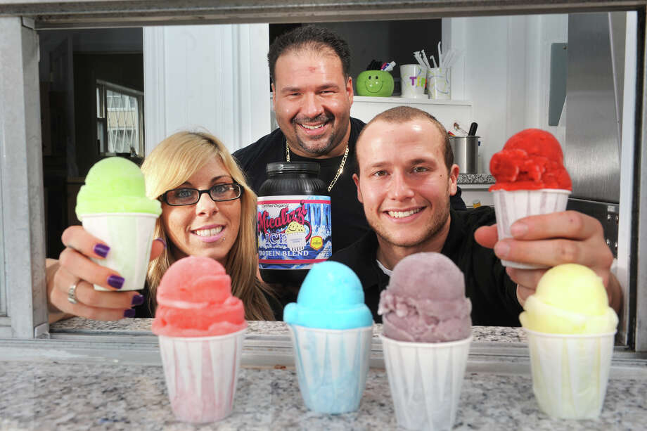 Owner Jay Piccirillo, center, poses in the service window at Micalizzi's Italian Ice with empoyees Nicole Meyer and Rob Gelozin in Bridgeport, Conn., May 31st, 2013. Photo: Ned Gerard / Connecticut Post