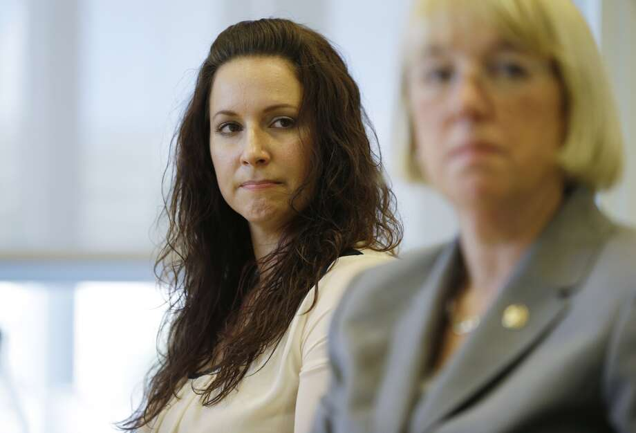 Nichole Bowen, left, formerly  of the U.S. Army, who identified herself as being a survivor of sexual  assault during her time in military service, listens to a question,  Friday, May 31, 2013 as she meets with reporters in Seattle about the  issue of sexual assault in the military. At right is U.S. Sen. Patty  Murray, D-Wash., who has introduced the Combating Military Sexual  Assault (MSA) Act of 2013, which aims to reduce sexual assaults within  the military and strengthen current law and policies. (AP Photo/Ted S.  Warren)