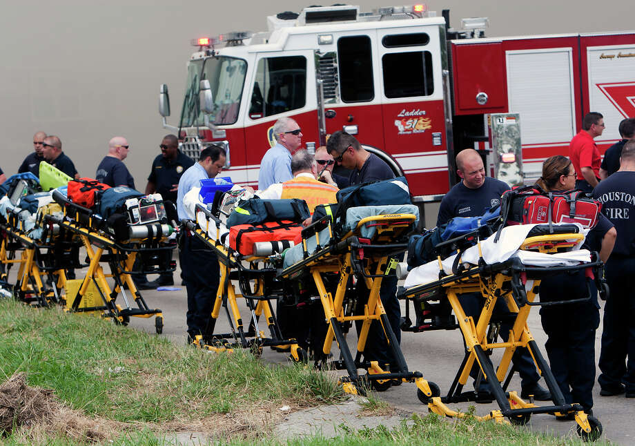 Medics line up in preparation to transport patients during a 4-alarm blaze at the Southwest Inn on Hornwood, Friday, May 31, 2013, in Houston. Four firefighters were transported in critical condition, and one was with a knee injury. Photo: Cody Duty, Houston Chronicle / © 2013 Houston Chronicle