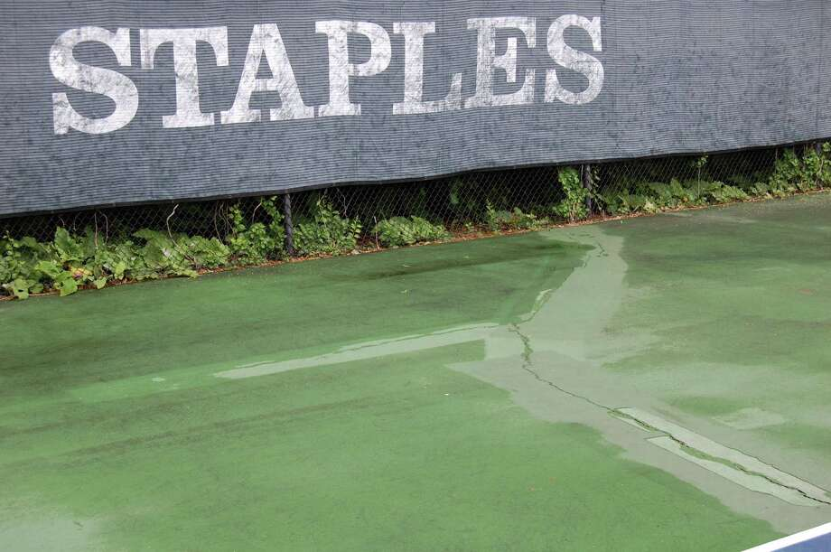 Cracks at the Staples High School tennis courts. Photo: Cameron Martin