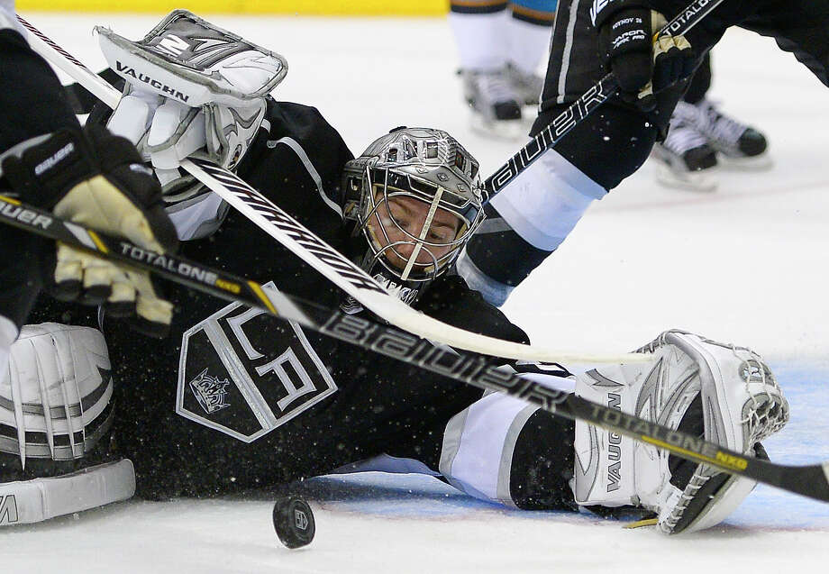 Los Angeles Kings goalie Jonathan Quick makes a save against the San Jose Sharks during the third period in Game 7 of the Western Conference semifinals in the NHL hockey Stanley Cup playoffs, Tuesday, May 28, 2013, in Los Angeles.  (AP Photo/Mark J. Terrill) Photo: Mark J. Terrill, Associated Press / AP