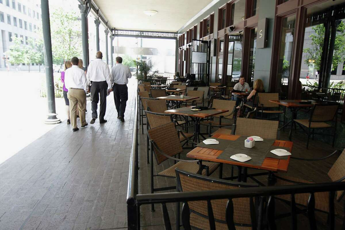 The Post Rice Lofts building provides shade for outside diners at Sambuca restaurant.