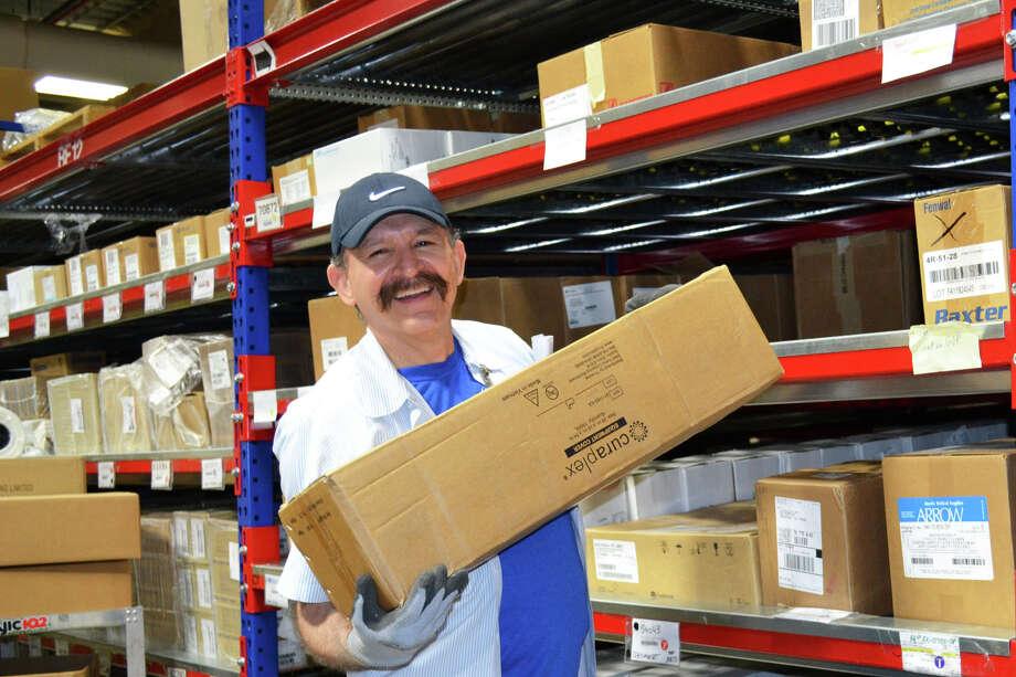 Supply tech Albert Garcia pulls items from the stockroom at the Michael E. DeBakey VA Medical Center.