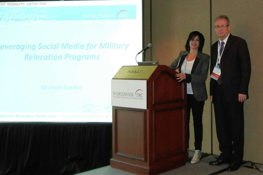 Michelle Sandlin and Lanny Valentine discuss social media at the relocation conference in San Diego.