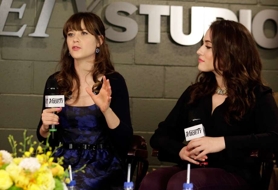 Actresses Zooey Deschanel and Kat Dennings attend the Variety Emmy Studio at Palihouse on May 29, 2013 in West Hollywood, California.