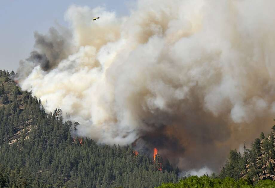 A wildfire in Santa Fe National Forest has burned 2,000 acres about 25 miles west of New Mexico's capital. Photo: Eddie Moore, Associated Press