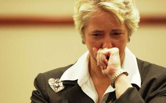 Mayor Annise Parker becomes emotional during a press conference at Memorial Hermann Hospital about the four firefighters that died fighting a 5-alarm hotel fire. Photo: Johhny Hanson/ Houston Chronicle