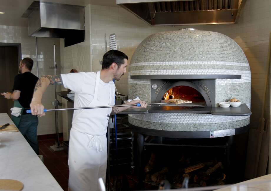 A huge ornate wooden fire oven for pizza at A16 Rockridge.