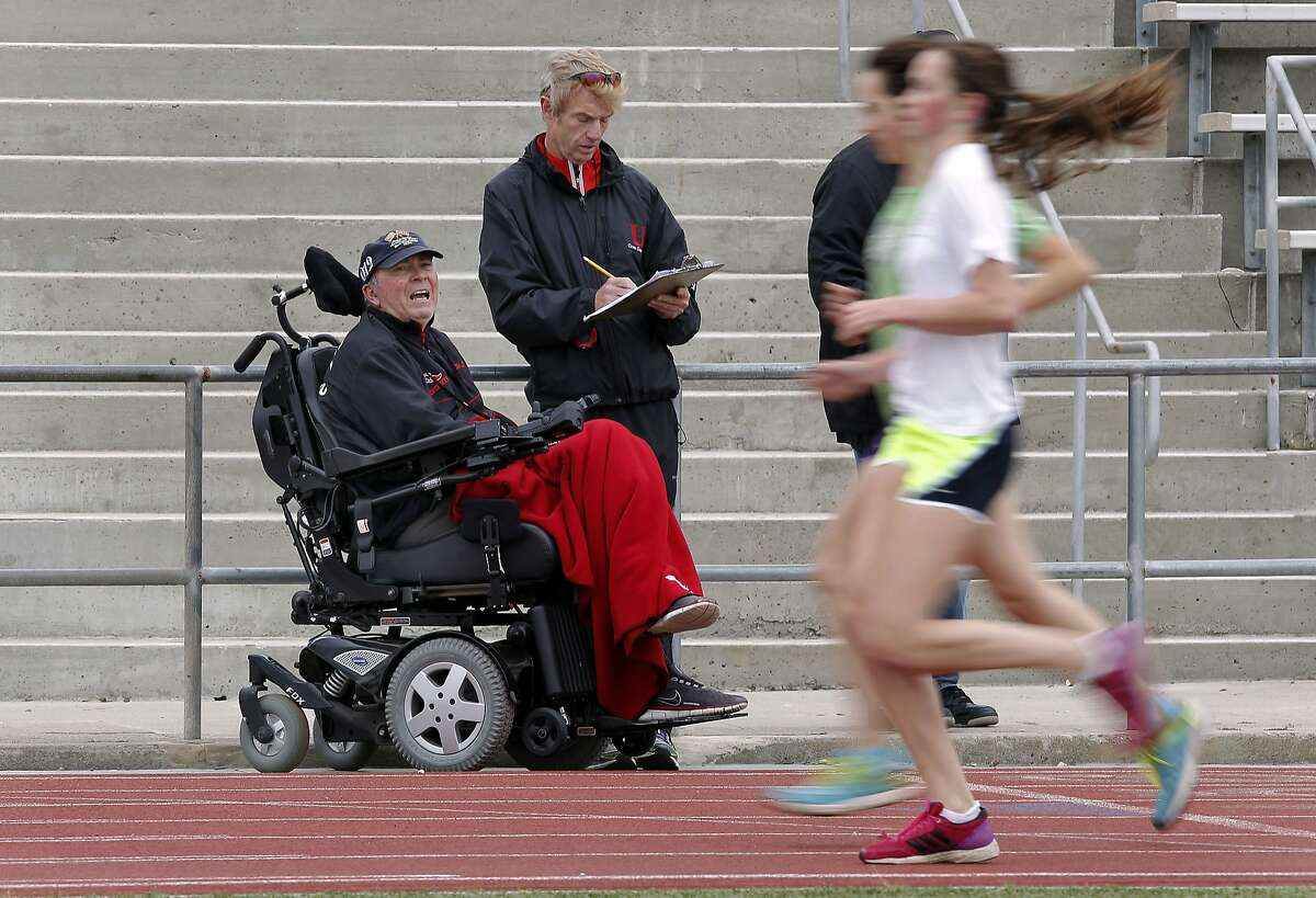 """Track coach Jim Tracy and assistant coach Kevin Cruikshank, with the University track team during a practice at Washington High School on Wednesday May 8, 2013, in San Francisco, Calif. University cross country coach Jim Tracy, who was diagnosed with ALS (Lou Gehrig's disease) 3 years ago and is still coaching state championship teams (the girls have won the last 4 state titles). He is the subject of """"Running for Jim, """" a documentary co-directed by ABC7's Dan Noyes."""