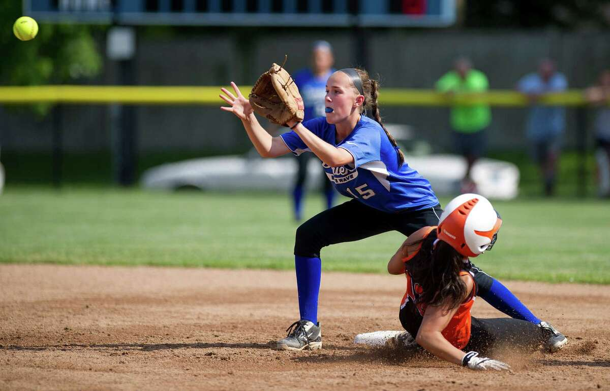 Stamford's Krista Robustelli is safe at second base as Darien's Avery Maley reaches for the ball during Friday's FCIAC quarterfinal softball game at Darien High School on May 31, 2013.