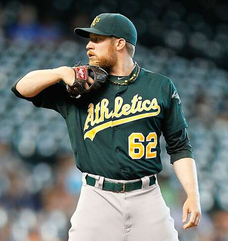 A's left-handed reliever Sean Doolittle was drafted as a first baseman, but decided he wanted to try pitching. Photo: Bob Levey, Getty Images