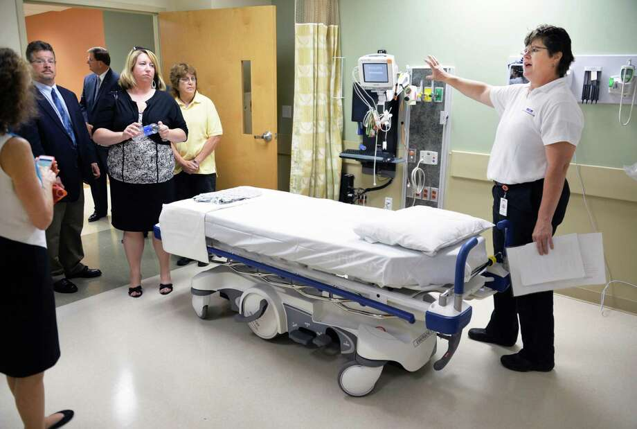 Cardio vascular technologist Debbie Artrip, at right, leads atour of the new Malta Med Emergent Care center in Malta, NY, Friday May 31, 2013.  (John Carl D'Annibale / Times Union) Photo: John Carl D'Annibale / 00022615A