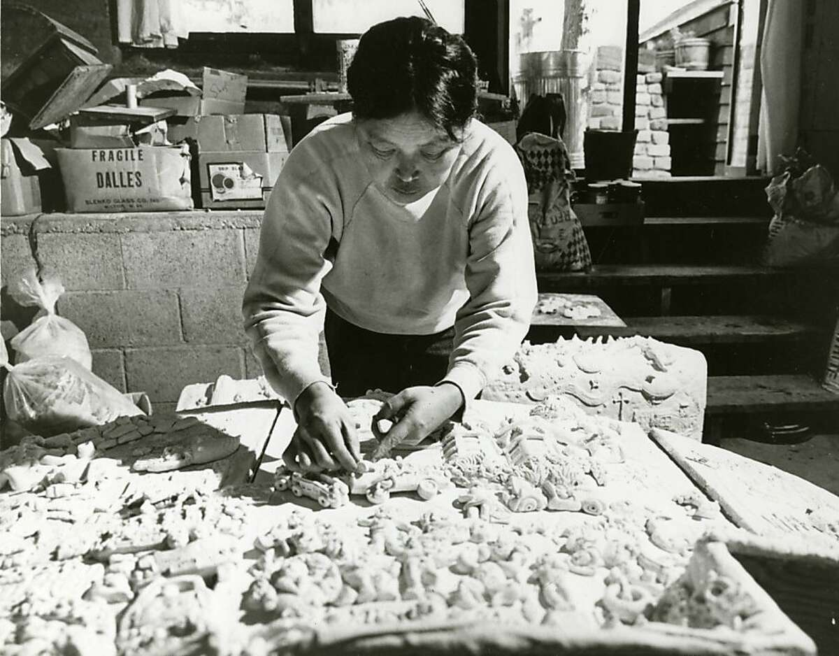 Sculptor Ruth Asawa arranges figures for the casting of her fountain for the plaza on the Hyatt Hotel at Union Square. Preliminary plans to relocate the downtown Apple Store to the site may mean the fountain would be dismantled.