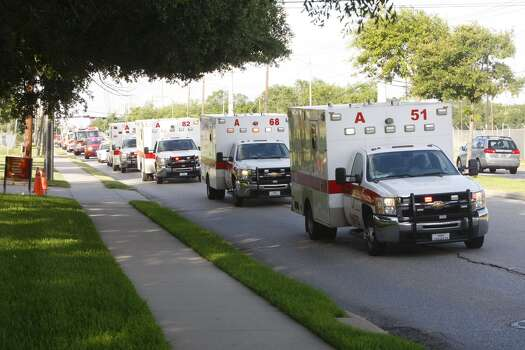 A procession of ambulances travel after a hotel fire that left four firefighters dead. (Cody Duty / Houston Chronicle) Photo: Cody Duty / Houston Chronicle