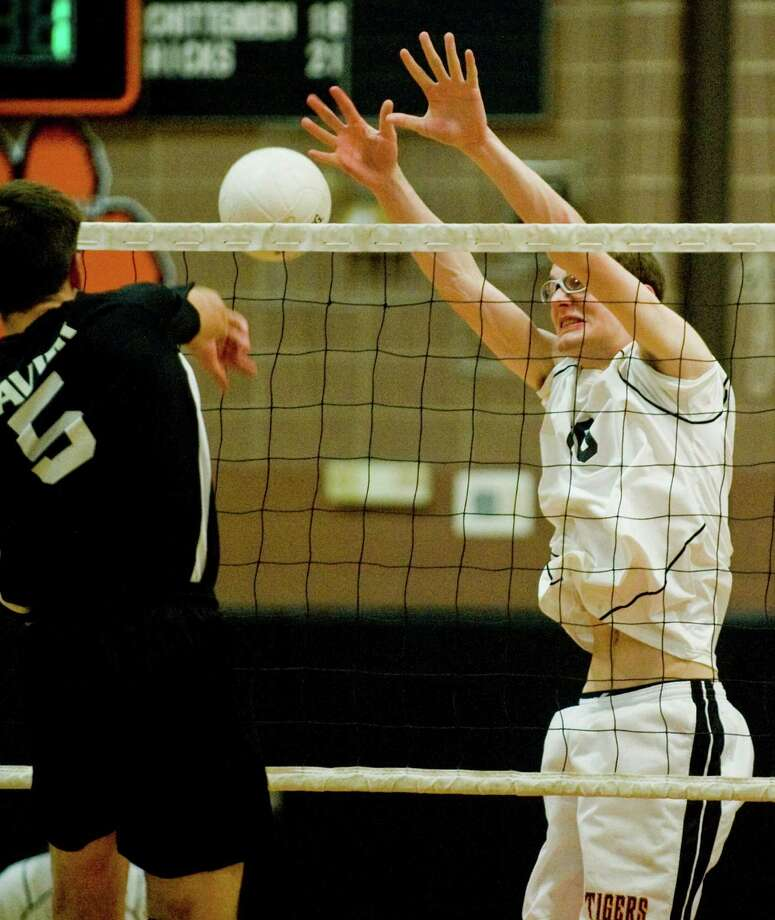 Ridgefield High School's David Linder blocks a shot during a Class L state quarterfinal Game against Xavier High School, played at Ridgefield. Friday, May 31, 2013 Photo: Scott Mullin / The News-Times Freelance