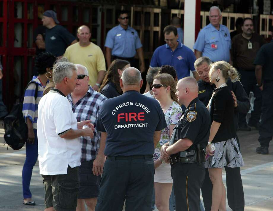 Houston Fire Department personnel and others mourn the loss of several firefighters who died today fighting a five alarm fire at a restaurant fire, outside HFD Station 51 Friday, May 31, 2013, in Houston. Photo: James Nielsen, Houston Chronicle / © 2013  Houston Chronicle
