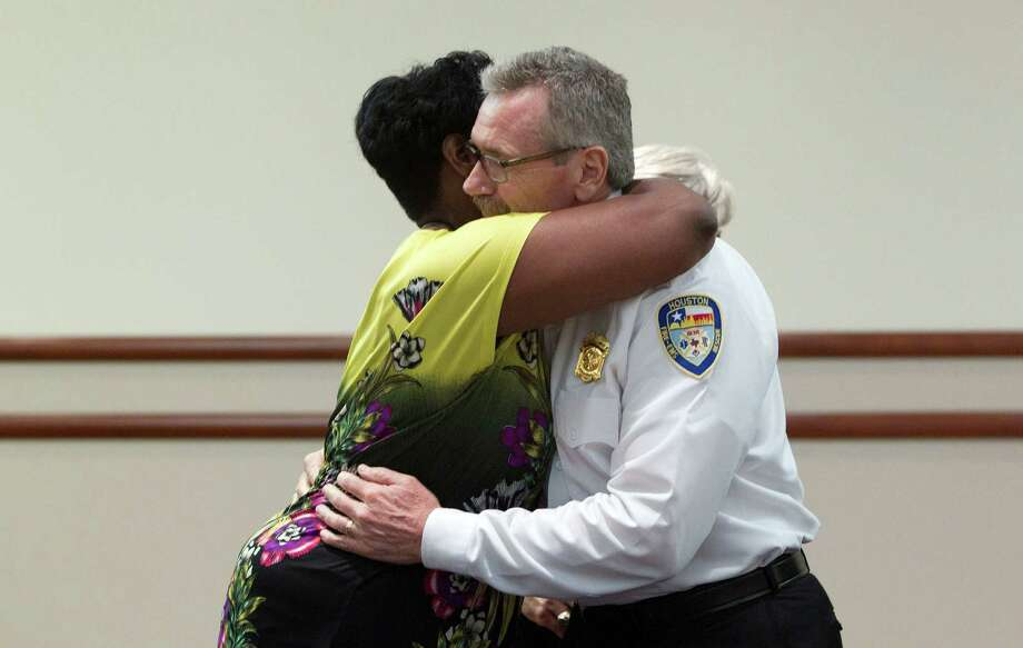 City Council Member Wanda Adams gives Houston Fire Chief Terry Garrison a hug after a press conference at Memorial Hermann Hospital about the four Houston firefighters that died fighting a 5-alarm blaze at a restaurant that then engulfed a hotel Friday, May 31, 2013, in Houston. The fire broke out at Bhojan Restaurant at 6855 Southwest Freeway at about 12:09 p.m. and engulfed the neighboring Southwest Inn along the Southwest Freeway near Hornwood, according to the Houston Fire Department. The flames also burned a sports bar and disco. Photo: Johnny Hanson, Houston Chronicle / © 2013  Houston Chronicle