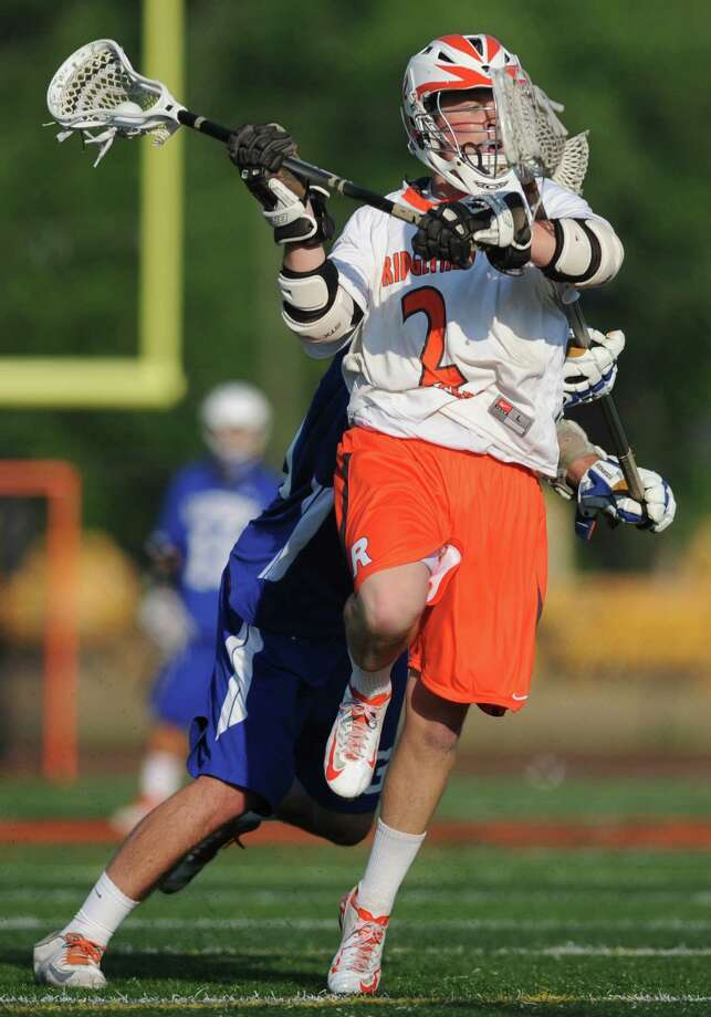 Ridgefield's David Arturi (2) shoots past a Glastonbury defender during No. 1 Ridgefield's 14-5 win over No. 8 Glastonbury in the quarterfinal round of the high school boys lacrosse Division L State Tournament at Ridgefield High School in Ridgefield, Conn. on May 31, 2013. Photo: Tyler Sizemore / The News-Times