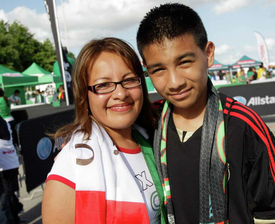 Fans participate in pregame festivities at Reliant Stadium before the Mexico and Nigeria soccer match. Photo: Melissa Phillip, Houston Chronicle / © 2013  Houston Chronicle
