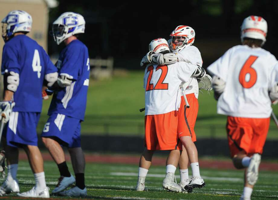 Ridgefield's William Bonaparte (22) and Brett Baker celebrate a goal during No. 1 Ridgefield's 14-5 win over No. 8 Glastonbury in the quarterfinal round of the high school boys lacrosse Division L State Tournament at Ridgefield High School in Ridgefield, Conn. on May 31, 2013. Photo: Tyler Sizemore / The News-Times