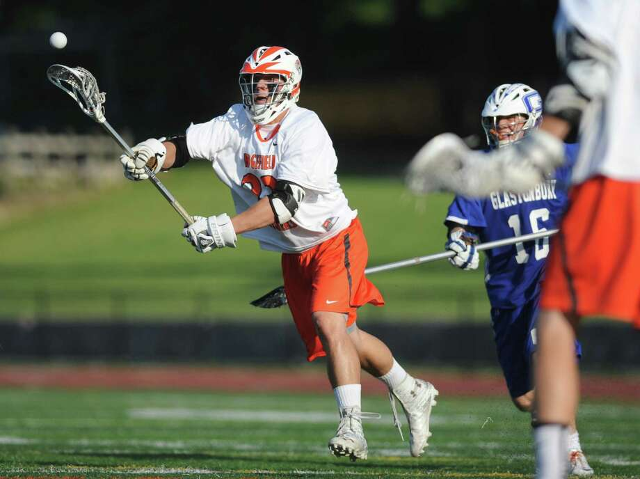 Ridgefield's William Bonaparte shoots during No. 1 Ridgefield's 14-5 win over No. 8 Glastonbury in the quarterfinal round of the high school boys lacrosse Division L State Tournament at Ridgefield High School in Ridgefield, Conn. on May 31, 2013. Photo: Tyler Sizemore / The News-Times