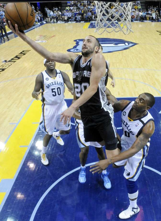 San Antonio Spurs' Manu Ginobili shoots around Memphis Grizzlies' Darrell Arthur during Game 4 of the 2013 Western Conference finals against the Memphis Grizzlies Monday May 27, 2013 at the FedEx Forum in Memphis, Tenn. The Spurs won 93-86.