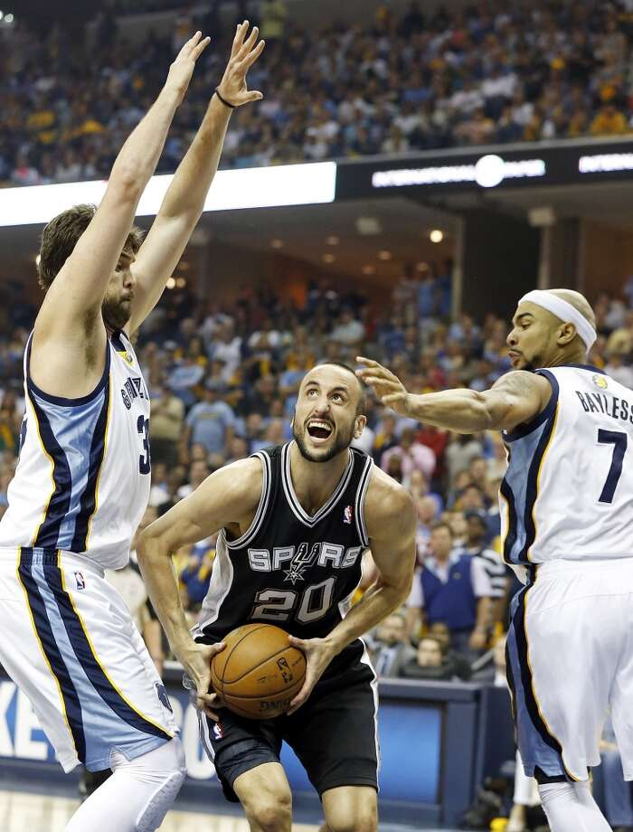 San Antonio Spurs' Manu Ginobili looks for room between Memphis Grizzlies' Marc Gasol and Memphis Grizzlies' Jerryd Bayless during first half action in Game 3 of the 2013 Western Conference finals Saturday May 25, 2013 at the FedEx Forum in Memphis, Tenn.