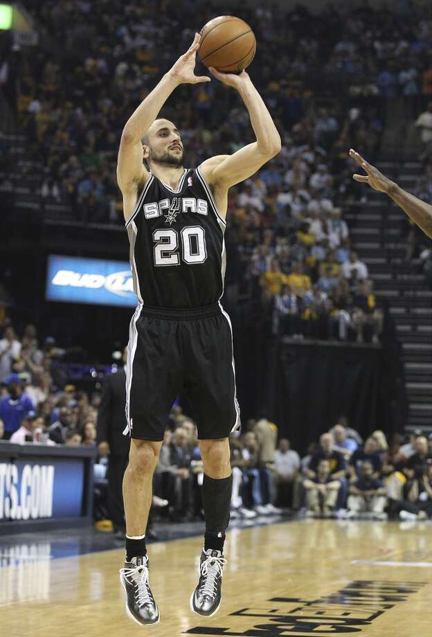 Spurs' Manu Ginobili (20) shoots a three against the Memphis Grizzlies in Game 3 of the 2013 Western Conference Finals at the FedEx Forum in Memphis on Saturday, May 25, 2013. Spurs defeated the Grizzlies, 104-93, in overtime. (Kin Man Hui/San Antonio Express-News)
