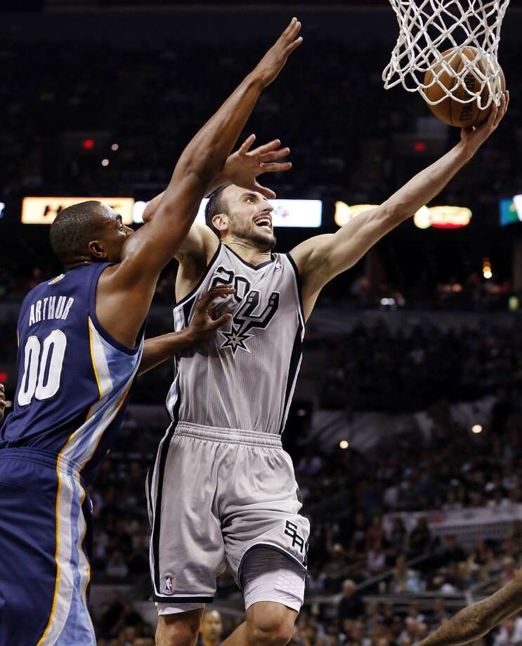 San Antonio Spurs' Manu Ginobili shoots around Memphis Grizzlies' Darrell Arthur during second half action of the 2013 Western Conference Finals Sunday May 19, 2013 at the AT&T Center. The Spurs won 105-83.