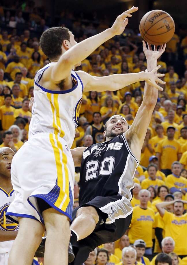 San Antonio Spurs' Manu Ginobili shoots around Golden State Warriors' Klay Thompson during second half action of Game 6 in the NBA Western Conference semifinals Thursday  May 16, 2013 at Oracle Arena in Oakland, CA. The Spurs won 94-82.