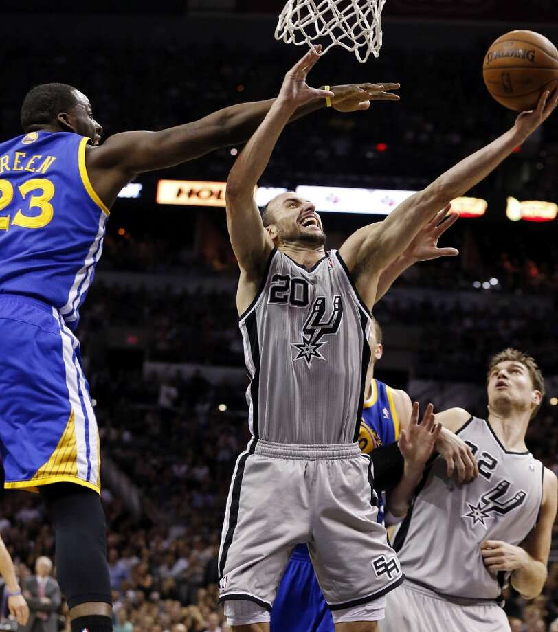 San Antonio Spurs' Manu Ginobili shoots around Golden State Warriors' Draymond Green during second half action of Game 5 in the NBA Western Conference semifinals Tuesday May 14, 2013 at the AT&T Center. The Spurs won 109-91.
