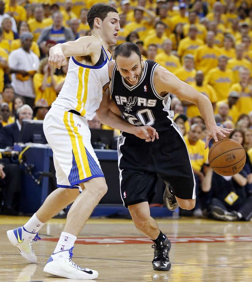 San Antonio Spurs' Manu Ginobili looks for room around Golden State Warriors' Klay Thompson during second half action of Game 3 in the NBA Western Conference semifinals Friday May 10, 2013 at Oracle Arena in Oakland, CA. The Spurs won 102-92.