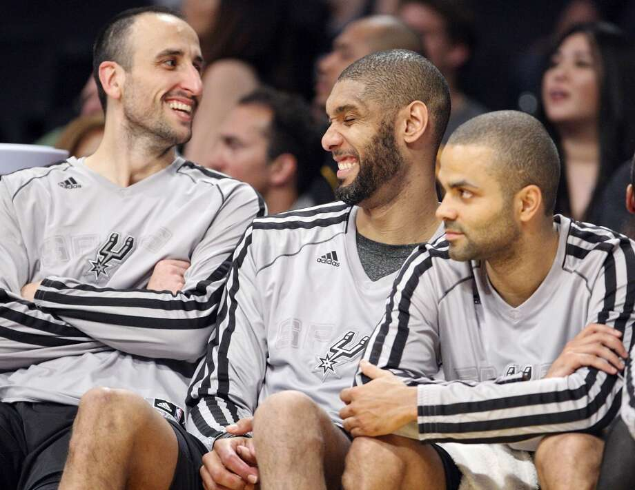 San Antonio Spurs' Manu Ginobili (from left) San Antonio Spurs' Tim Duncan, and San Antonio Spurs' Tony Parker joke on the bench during second half action of game 4 in the first round of the NBA Playoffs against the Los Angeles Lakers Sunday April 28, 2013 at the Staples Center in Los Angeles, CA. The Spurs won 103-82.