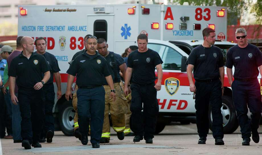 Firefighters leave after taking the bodies of the four fallen firefighters to the Forensic Center of Harris County to be examined, Friday, May 31, 2013, in Houston. Photo: Cody Duty, Houston Chronicle / © 2013 Houston Chronicle