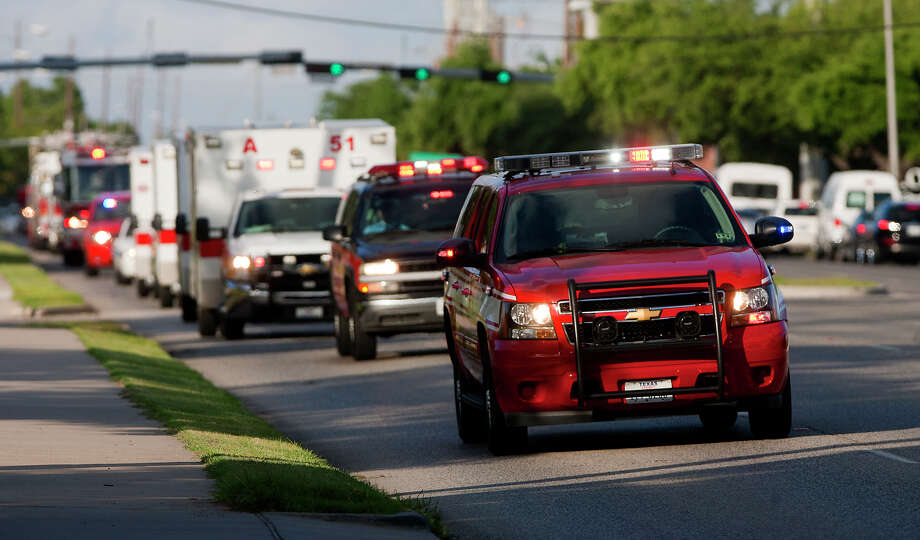 A procession carrying the bodies of the four fallen firefighters drive to the Forensic Center of Harris County to be examined, Friday, May 31, 2013, in Houston. The firefighters died fighting a five-alarm fire at the Southwest Inn earlier in the day. Photo: Cody Duty, Houston Chronicle / © 2013 Houston Chronicle