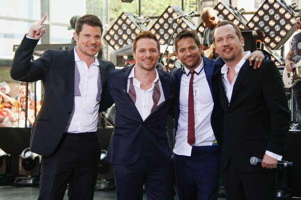 """NEW YORK, NY - MAY 31: 98 Degrees (L-R) Nick Lachey, Drew Lachey, Jeff Timmons and Justin Jeffre perform on NBC's """"Today"""" at the NBC's TODAY Show on May 31, 2013 in New York, New York. (Photo by Janette Pellegrini/Getty Images)"""