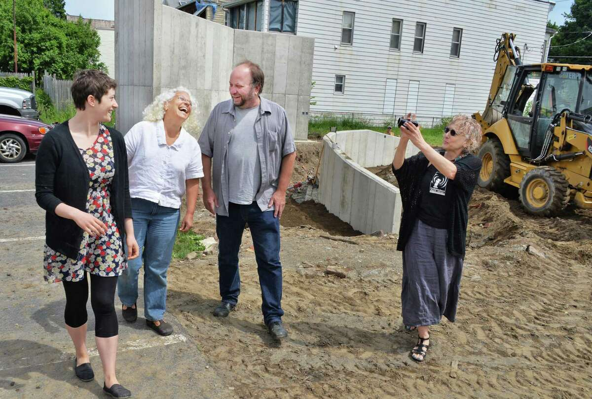 Project members, from left, Jillian Hirsch, Robekah Rice, Steve Pierce and Branda Miller tour the Freedom Square construction site in Troy, NY, Tuesday May 28, 2013. (John Carl D'Annibale / Times Union)