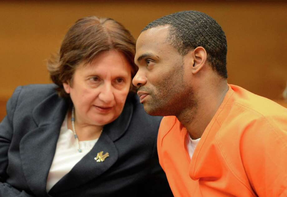 James Wells, speaks with his defense attorney Cheryl Coleman in Judge Michael V. Coccoma's court in Schenectady, N.Y.   ( Skip Dickstein/Times Union ) Photo: Skip Dickstein / 00022626A