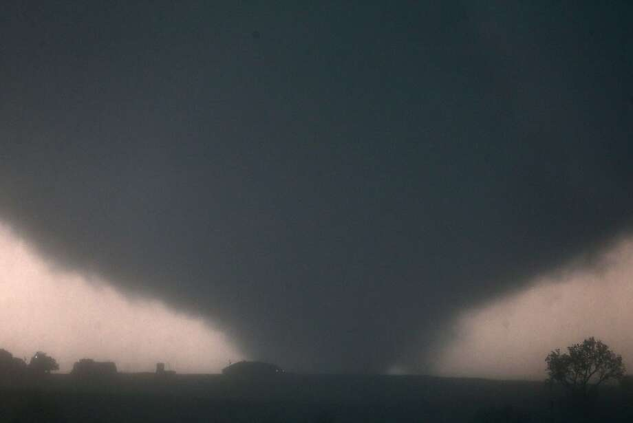 A tornado hits near El Reno, Okla., killing at least one person, damaging structures and injuring travelers on Interstate 40. Photo: Chris Machian, Associated Press