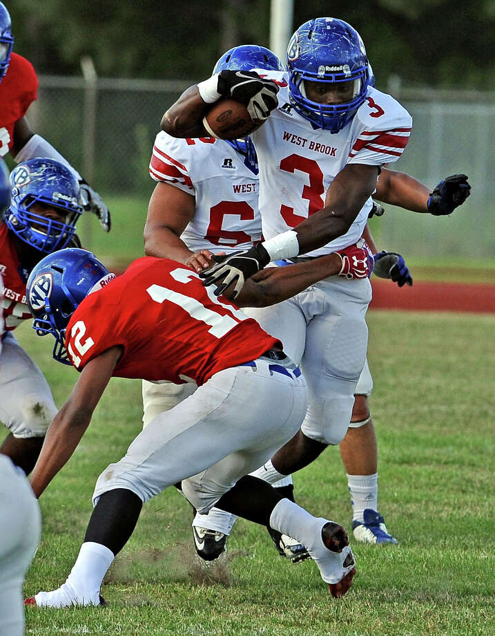 West Brook player Justen Hervey, #3, works his way up the middle during their spring football game on Friday, May 31, 2013, at Alex Durley Stadium. Photo taken: Randy Edwards/The Enterprise Photo: Randy Edwards