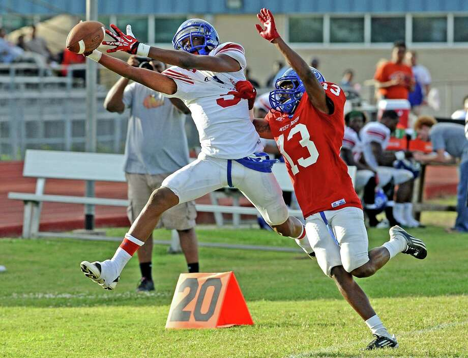 West Brook player Moses Gallow, 13, hits Keith Corbin, #9, out of bounds during their spring football game on Friday, May 31, 2013, at Alex Durley Stadium. Photo taken: Randy Edwards/The Enterprise Photo: Randy Edwards