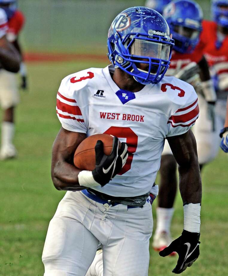West Brook player Justen Hervey, #3, makes a run to the outside during their spring football game on Friday, May 31, 2013, at Alex Durley Stadium. Photo taken: Randy Edwards/The Enterprise Photo: Randy Edwards