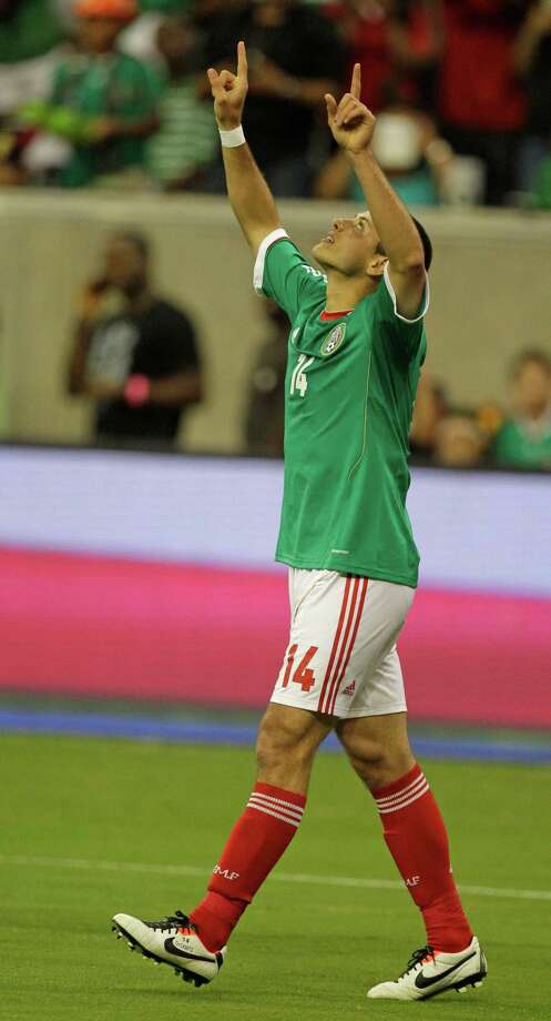 Mexico player Javier Hernandez celebrates his goal during the first half of game against Nigeria at Reliant Stadium Friday, May 31, 2013, in Houston. Photo: Melissa Phillip, Houston Chronicle / © 2013  Houston Chronicle