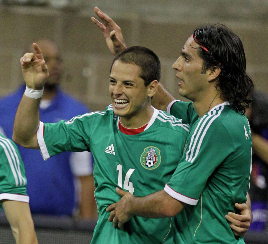Mexico player Javier Hernandez, left, celebrates his goal with teammate Aldo De Nigris during the first half of game against Nigeria at Reliant Stadium Friday, May 31, 2013, in Houston. Photo: Melissa Phillip, Houston Chronicle / © 2013  Houston Chronicle