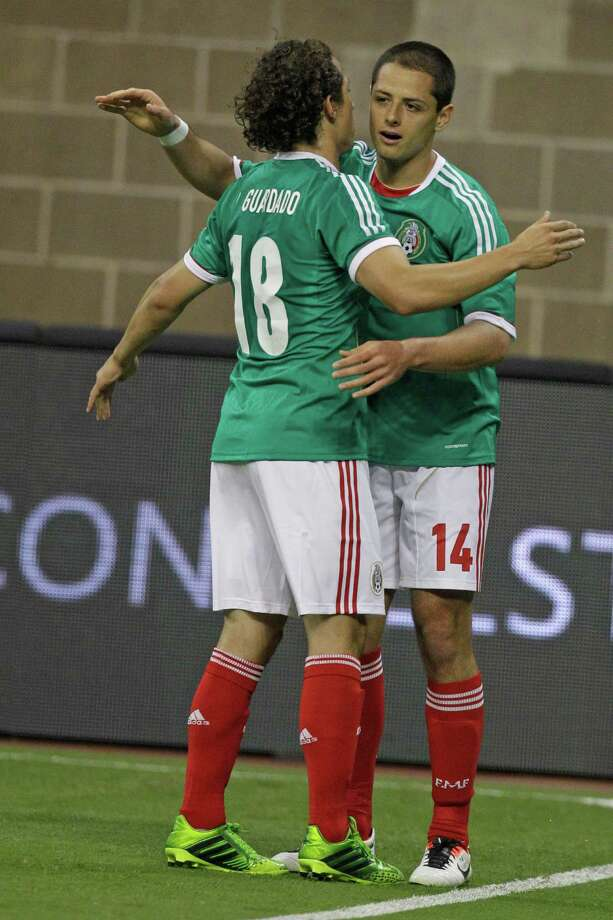 Mexico player Javier Hernandez, right, celebrates his goal with teammate Andres Guardado during the first half of game against Nigeria at Reliant Stadium Friday, May 31, 2013, in Houston. Photo: Melissa Phillip, Houston Chronicle / © 2013  Houston Chronicle