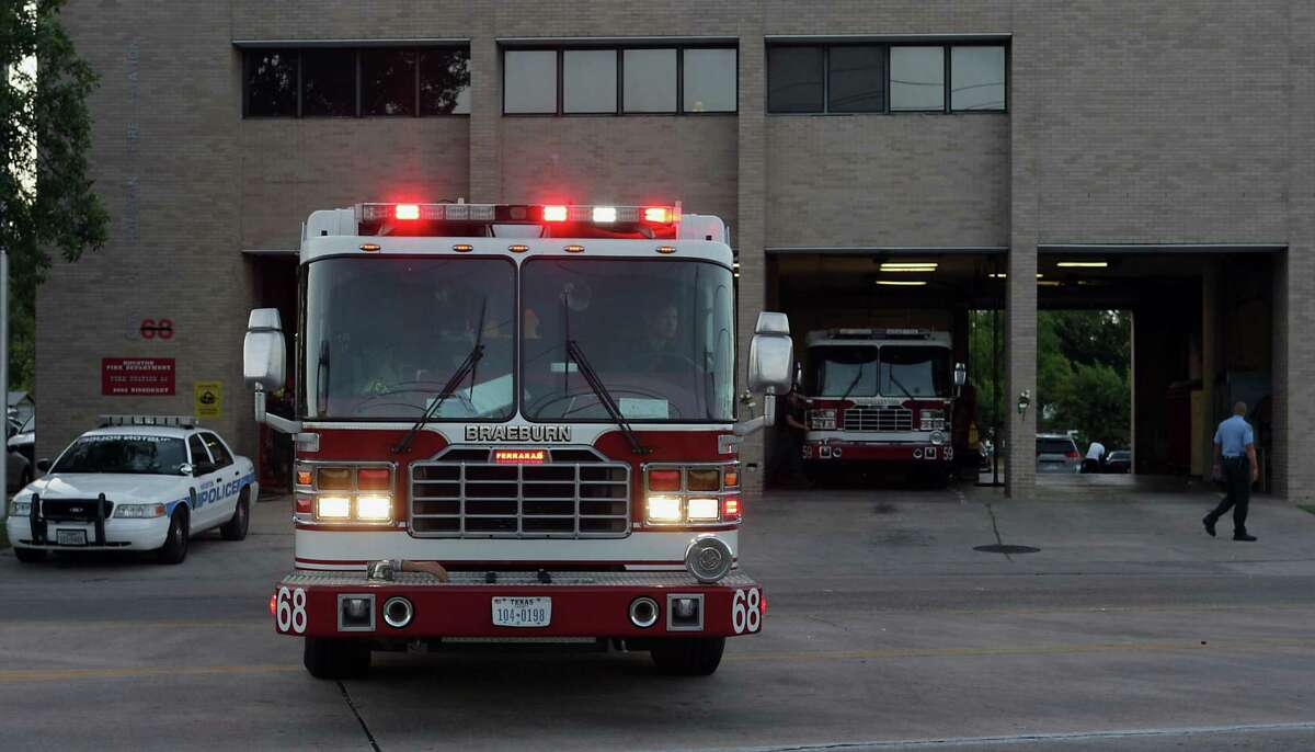 A fire engine backs into the Houston Fire Department Station 68 on Friday, May 31, 2013, in Houston. Firefighters' complaints about pay and gear are not new.