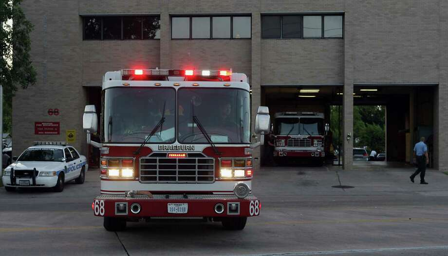 A fire engine backs into the Houston Fire Department Station 68 on Friday, May 31, 2013, in Houston. Firefighters' complaints about pay and gear are not new.  Photo: James Nielsen, Houston Chronicle / © 2013  Houston Chronicle