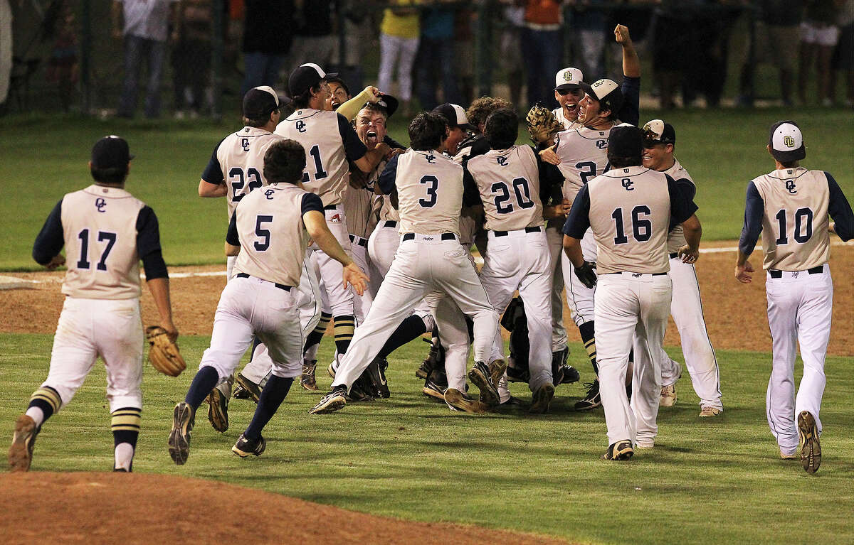 O'Connor players rush the field after the last out to defeat Eagle Pass, 3-2, and move onto the state tournament on Friday, May 31, 2013.