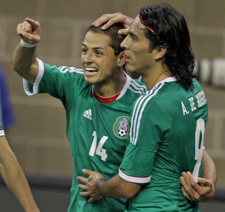 Mexico player Javier Hernandez, left, and celebrates his goal with teammate Aldo De Nigris during th first half of game against Nigeria  at Reliant Stadium Friday, May 31, 2013, in Houston. Photo: Melissa Phillip, Houston Chronicle / © 2013  Houston Chronicle