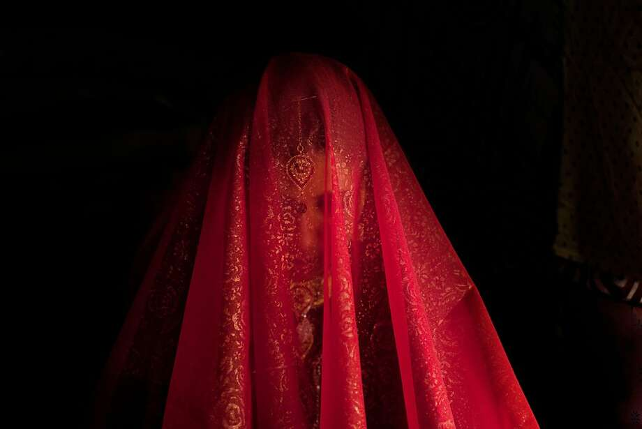 Zareena, a Kashmiri Bakarwal bride sits inside a temporary campwith her face covered with scarf during her wedding ceremony on the outskirts of Srinagar, India, Friday, May 31, 2013. Bakarwals are nomadic herders in Jammu Kashmir state, who wander in search of good pastures for their cattle. (AP Photo/Dar Yasin) Photo: Dar Yasin, Associated Press